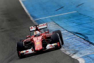 German Formula One driver Sebastian Vettel of Scuderia Ferrari steers his new SF15-T during a ...
