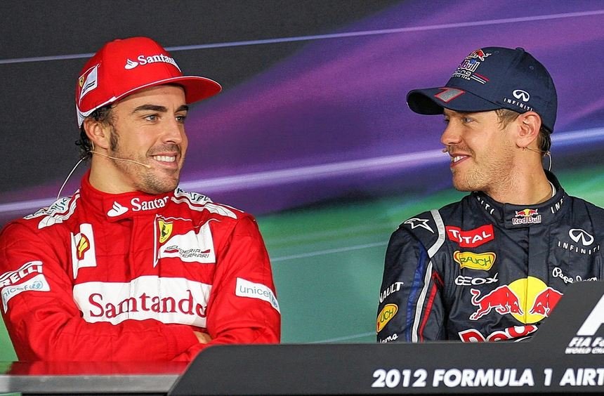 Der Schein trügt: Fernando Alonso und Sebastian Vettel lächeln nur äußerlich - im WM-Kampf sind sie ...
